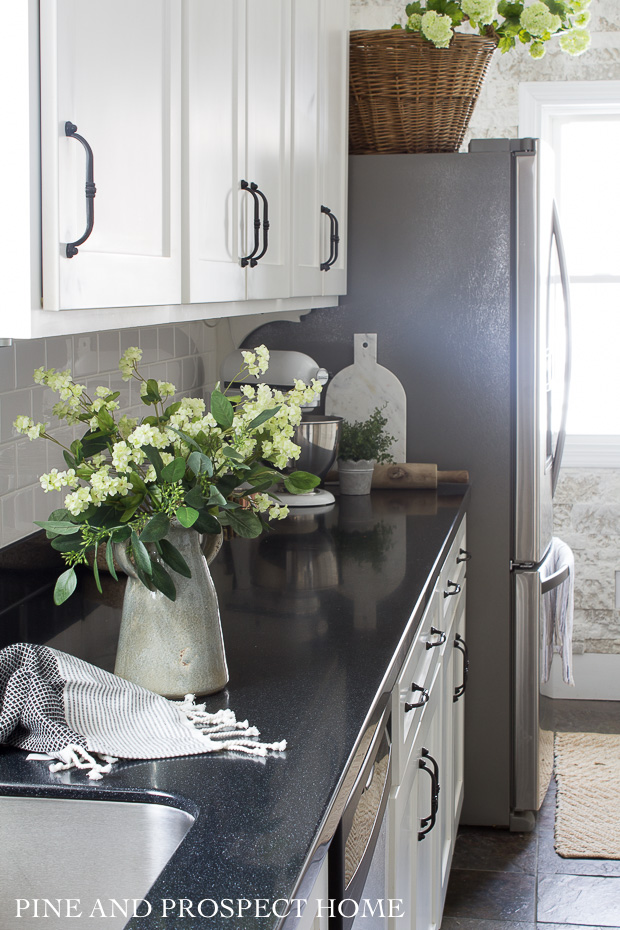 white cottage style kitchen with summer touches