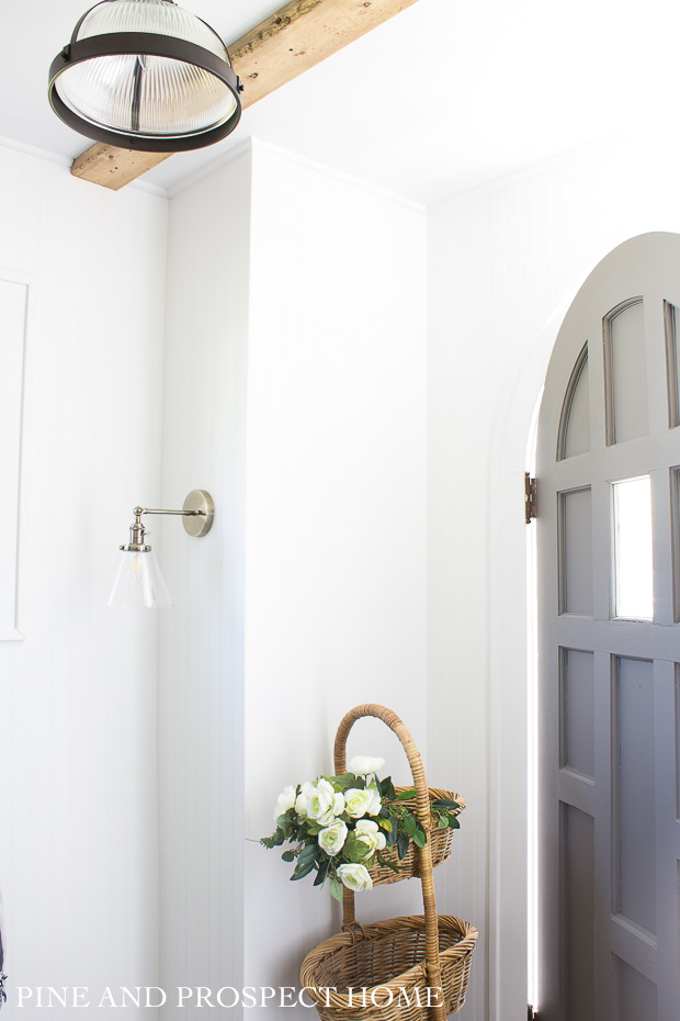 We used classic bead board with brass fixtures in our entryway