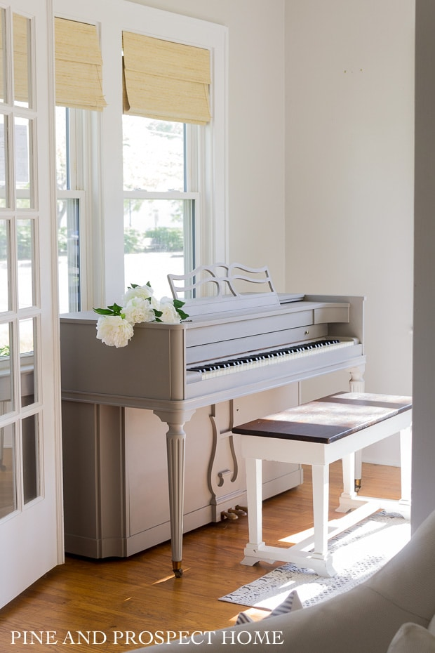 Our sunroom is the perfect spot for our newly painted piano!