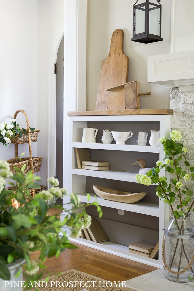 Our DIY builtins hold all of my white vintage pitchers - I love the combination of woods and whites.
