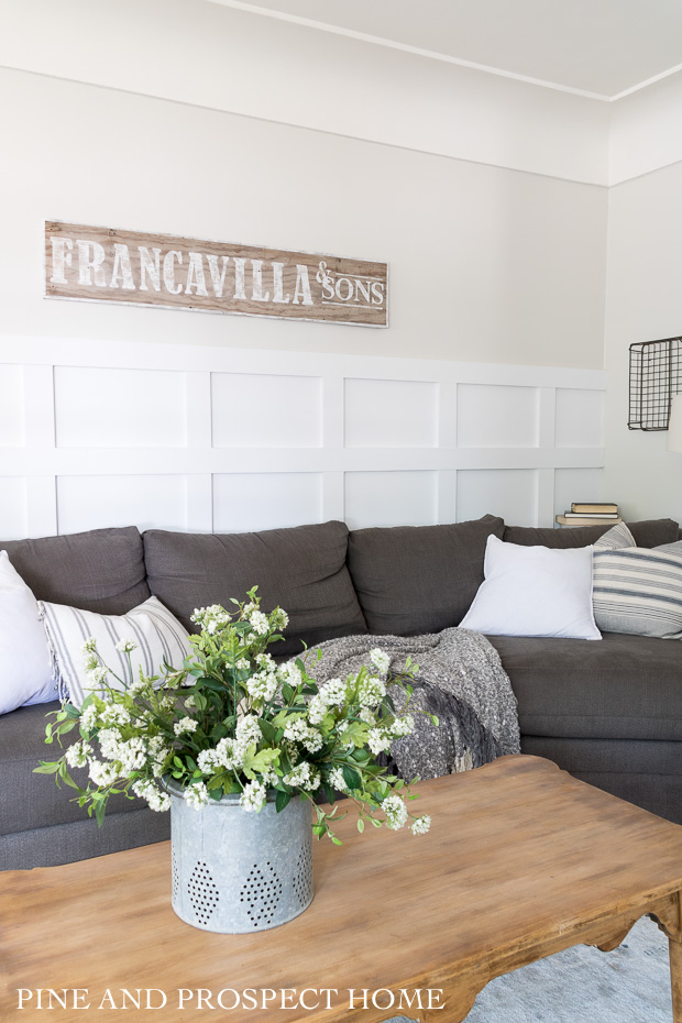 This DIY sign is perfect above the couch and I love how it personalizes the space!