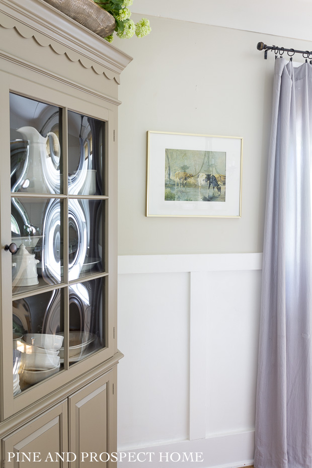 My vintage cow print is a beautiful pop of color next to our corner hutch